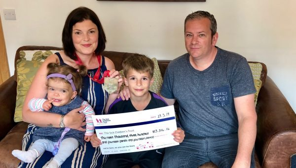 Family feature in new film and celebrate raising over £14,000