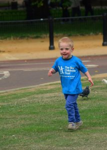 A happy Henry running outside