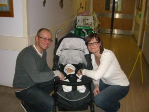 Henry in a pram with his parents