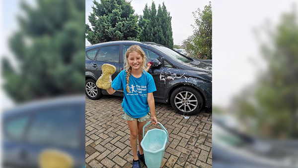 Nine year old's charity car wash gives family with child in hospital a place to stay